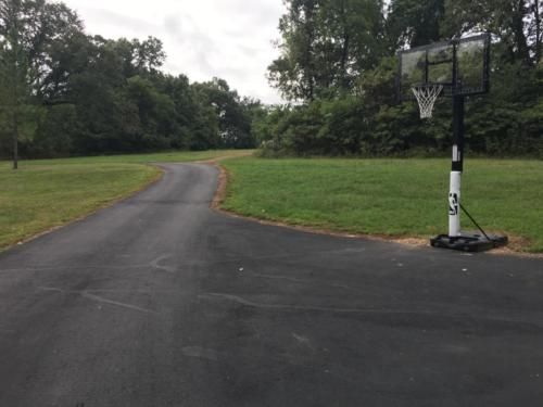 Basketball area and drive to west entrance